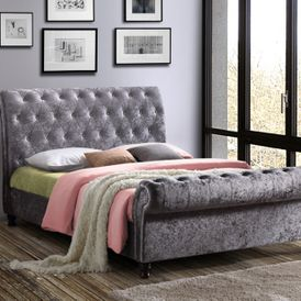 A double bed with a head board