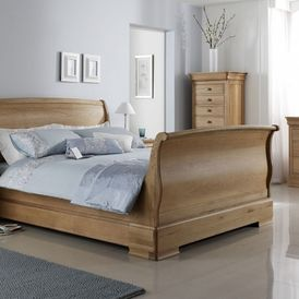 A wooden bed with head board